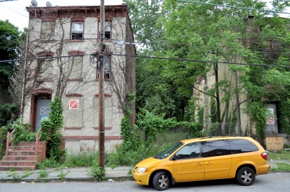 Taxi Van With Abandoned Buildings T